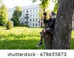 the girl photographer takes... | Shutterstock . vector #678655873