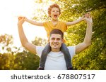 blonde laughing kid riding on... | Shutterstock . vector #678807517