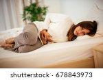 beautiful young woman lying on... | Shutterstock . vector #678843973