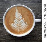 top view of a mug of latte art...   Shutterstock . vector #678873793