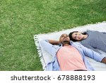 young multiethnic couple lying... | Shutterstock . vector #678888193