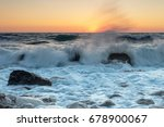 smashing waves at sunset | Shutterstock . vector #678900067