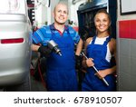 two cheerful technicians in... | Shutterstock . vector #678910507