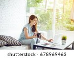 asia woman using laptop and... | Shutterstock . vector #678969463