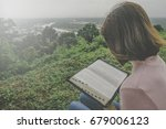 woman reading holy bible on...   Shutterstock . vector #679006123