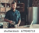 handsome bearded young man is... | Shutterstock . vector #679040713