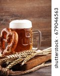 beer in a mug. oktoberfest... | Shutterstock . vector #679046563