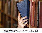 hand holds book. | Shutterstock . vector #679068913