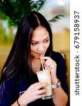 beautiful girl drinking ice... | Shutterstock . vector #679158937