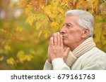 thinking senior man praying  | Shutterstock . vector #679161763