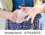 the girl wipes her hands with a ... | Shutterstock . vector #679163023