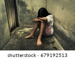 sad little girl sitting against ... | Shutterstock . vector #679192513