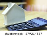 house model and calculator on... | Shutterstock . vector #679214587