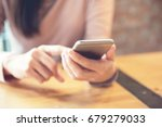 woman hand holding smartphone... | Shutterstock . vector #679279033