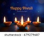 happy diwali   lit diya lamps... | Shutterstock . vector #679279687