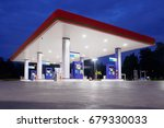 gas station at night time | Shutterstock . vector #679330033