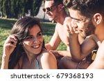 attractive girl adjusting her... | Shutterstock . vector #679368193
