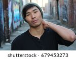 asian man with piercing and... | Shutterstock . vector #679453273
