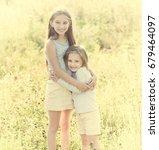 sibling sisters hugging each in ...   Shutterstock . vector #679464097