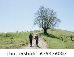 two men holding hands each... | Shutterstock . vector #679476007