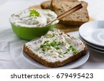 fresh cheese spread served on... | Shutterstock . vector #679495423