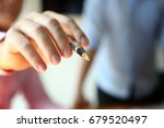 Small photo of Pen tip Hand young business man