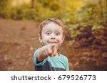 joyful and surprised boy... | Shutterstock . vector #679526773