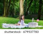 beautiful little girl in a park ... | Shutterstock . vector #679537783