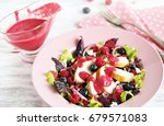 salad with raspberries and... | Shutterstock . vector #679571083