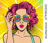 Wow pop art face. Sexy surprised woman with pink curly hair and open mouth holding sunglasses in her hand with inscription wow in reflection. Vector colorful background in pop art retro comic style. | Shutterstock vector #679581043
