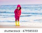 happy little girl running and... | Shutterstock . vector #679585333