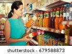 positive woman customer buying... | Shutterstock . vector #679588873