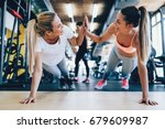 two attractive fitness girls... | Shutterstock . vector #679609987