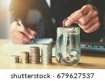 saving money woman hand putting ... | Shutterstock . vector #679627537