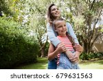smiling woman and daughter... | Shutterstock . vector #679631563