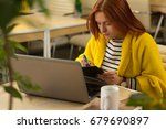 shot of a young businesswoman...   Shutterstock . vector #679690897