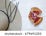 straw hat and fruits cake on... | Shutterstock . vector #679691203
