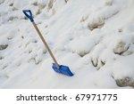 Blue Plastic Shovel On A Snow...
