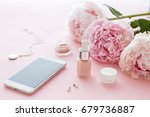 cosmetics bottles on the pink... | Shutterstock . vector #679736887