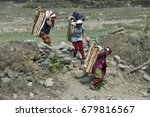 Three Women Carry Firewood...