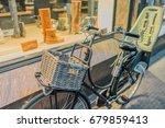 vintage bicycle with the child... | Shutterstock . vector #679859413