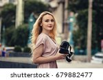young blonde girl using vr... | Shutterstock . vector #679882477