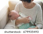 asian grandmother and her... | Shutterstock . vector #679935493