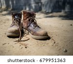 Heavily Used Work Boots On The...