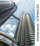 Small photo of Kaula Lumpur, Malaysia - Jun 19, 2017 : The unique aspect to see the greatest and tallest twin tower asia, Petronas Twin Towers, Kuala Lumpur, Malaysia.