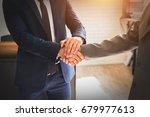 businessman shaking hand after... | Shutterstock . vector #679977613