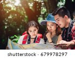 group of asian friends hiking... | Shutterstock . vector #679978297