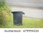 black bin by the roadside. | Shutterstock . vector #679994233