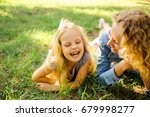 mom and daughter lie on the... | Shutterstock . vector #679998277