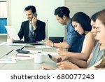 smiling business man having a... | Shutterstock . vector #680077243